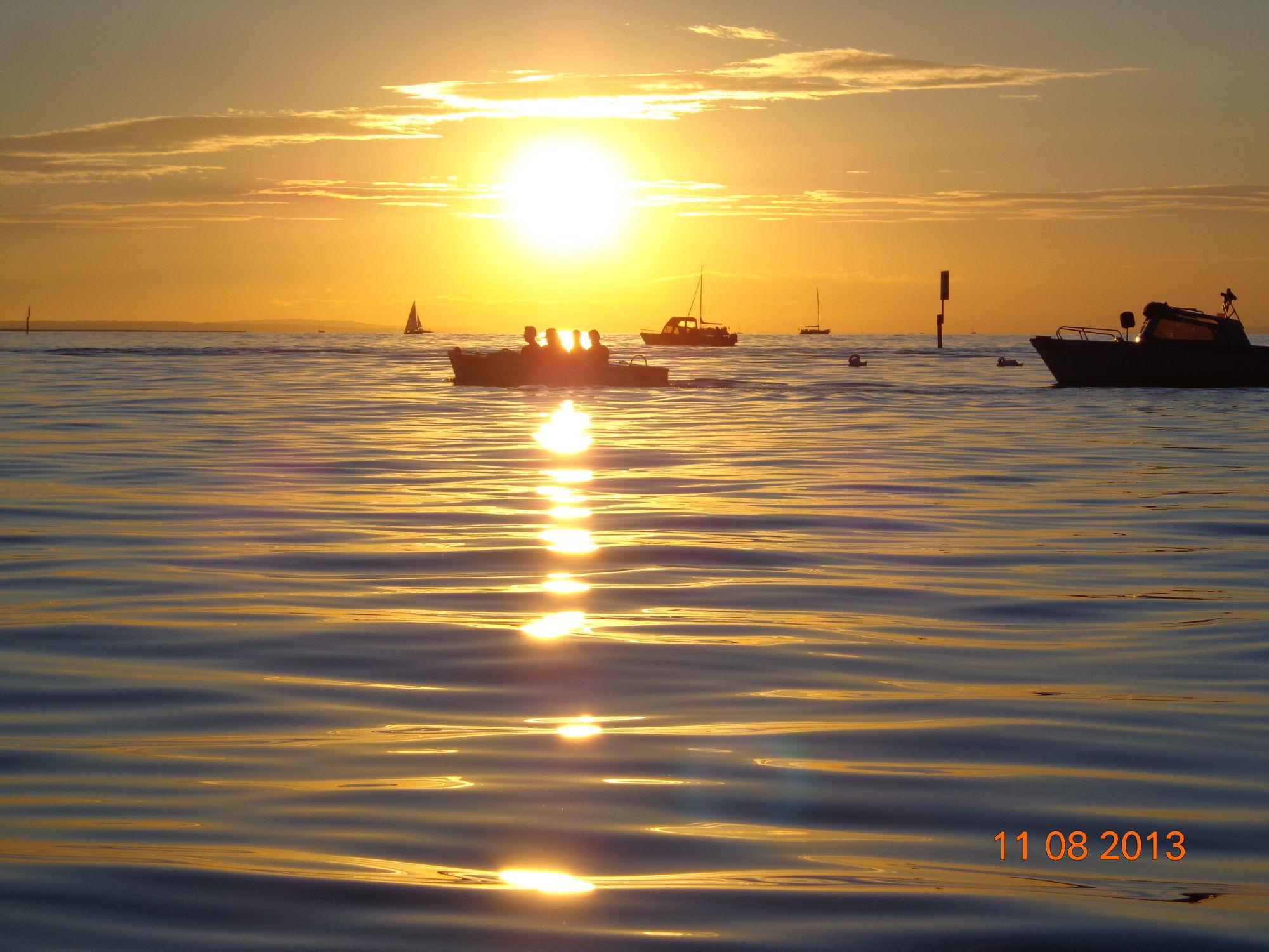 Bild mit Sonnenuntergang, Segelboote, Sonnenaufgang