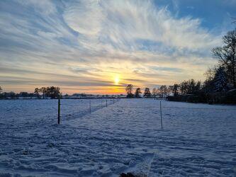 Bild mit Sonnenuntergang, winterlandschaft